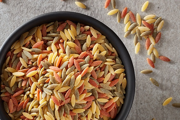 tri-colored orzo in bowl overhead