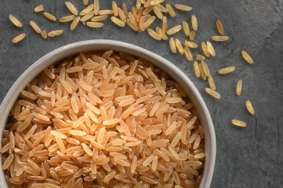 long grain parboiled brown rice in metal bowl overhead