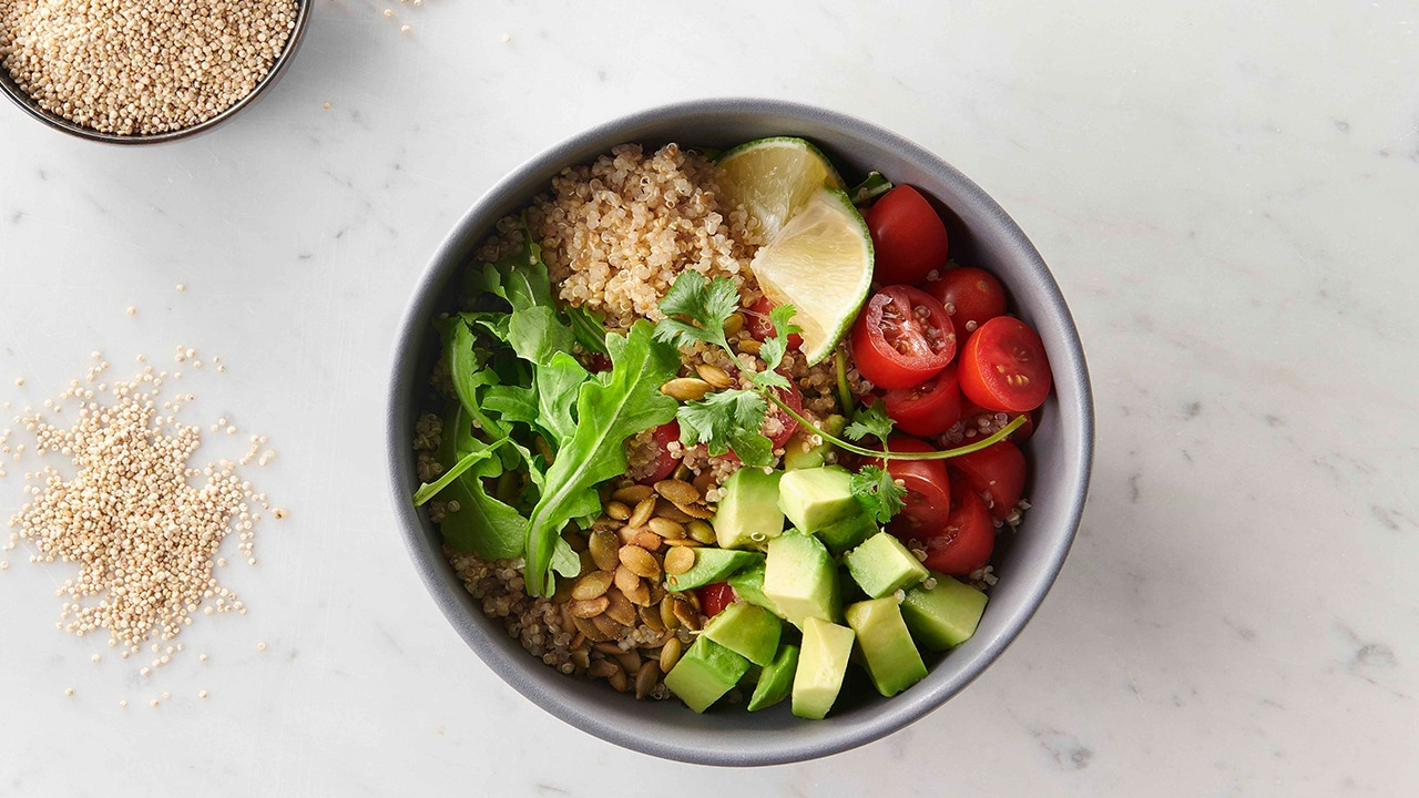 honey lime quinoa salad in bowl overhead